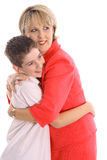 Woman hugging boy Stock Photo