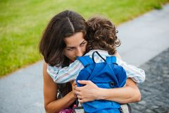 A woman is hugging a boy. Royalty Free Stock Images