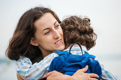 A woman is hugging a boy. Royalty Free Stock Image