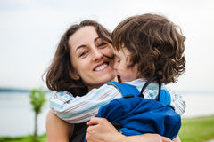A woman is hugging a boy. Royalty Free Stock Photography