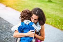 A woman is hugging a boy. Royalty Free Stock Photos