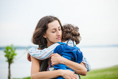 A woman is hugging a boy. Stock Photo