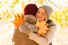 Woman hugging boyfriend fall Royalty Free Stock Photo