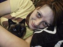Woman hugging cat Royalty Free Stock Photos