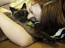 Woman hugging cat Royalty Free Stock Image