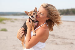 Woman hugging Chihuahua dog Stock Images