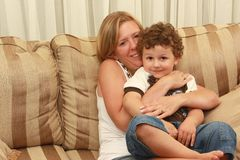 Woman hugging child Royalty Free Stock Photos