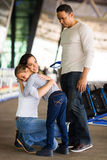 Woman hugging daughter airport Royalty Free Stock Photos