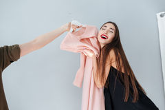 Free Woman Hugging Dress In Clothing Store Stock Photos - 70555223