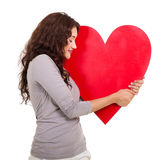 Woman hugging heart Stock Images