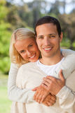 Woman hugging her boyfriend Stock Photography