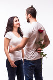 Woman hugging her boyfriend and holding the rose Royalty Free Stock Photography