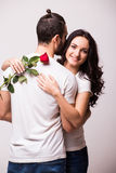 Woman hugging her boyfriend and holding the rose Stock Images