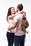 Woman hugging her boyfriend and holding the rose Stock Photo