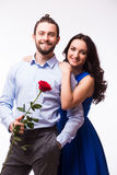 Woman hugging her boyfriend holding the rose Royalty Free Stock Image