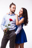 Woman hugging her boyfriend holding the rose Stock Photo