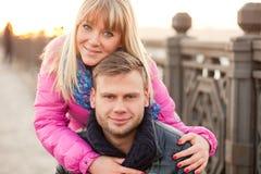 Woman is hugging her boyfriend in winter Royalty Free Stock Photo