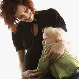 Woman hugging her daughter Stock Photography