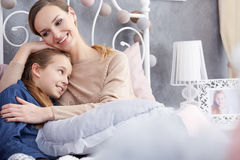 Woman hugging her daughter Stock Image