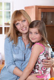 Woman hugging her daughter Stock Photo