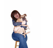 Woman hugging her dog. Stock Image