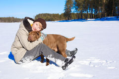 Woman hugging her dog Royalty Free Stock Image