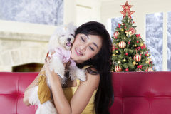 Woman hugging her dog on the sofa at home Stock Photos