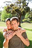 Woman hugging her handsome husband Stock Photography
