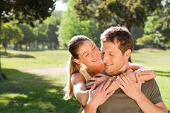 Woman hugging her handsome husband Royalty Free Stock Photo