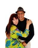 Woman hugging her Hispanic man. Royalty Free Stock Photos