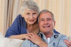 Woman hugging her husband Stock Photos
