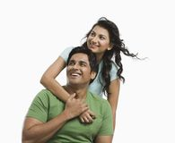 Woman hugging her husband from behind Stock Photo