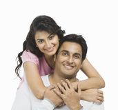 Woman hugging her husband from behind Stock Image