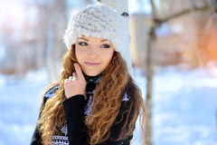 Woman hugging herself cold in winter time Stock Images