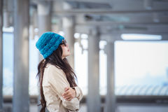 Woman hugging herself and looking away with winter lonely emotio Royalty Free Stock Images