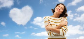 Free Woman Hugging Herself Over Heart Shaped Cloud Royalty Free Stock Image - 145199866