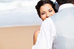 Woman hugging husband Stock Photography