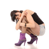 Woman hugging knees Stock Photo