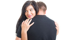 Woman hugging man and looking away Stock Image