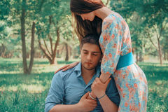 Woman hugging a man in summer park Stock Image
