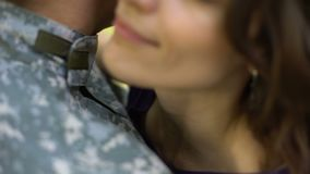 Woman hugging military husband, air forces serviceman leaving for work, couple