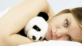 Woman hugging panda plush falling asleep stock video footage