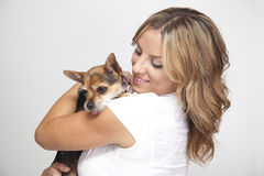 Woman hugging pet dog Royalty Free Stock Photos