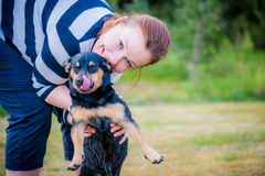 Woman hugging pet dog Stock Photo