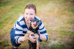 Woman hugging pet dog Royalty Free Stock Images