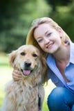 Woman Hugging Pet Golden Retriever Royalty Free Stock Photos
