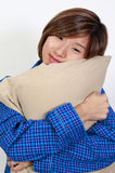 Woman Hugging Pillow Stock Photo