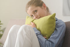 Woman hugging a pillow Royalty Free Stock Image