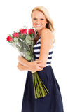Woman hugging roses Stock Image