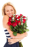 Woman hugging roses Stock Photos